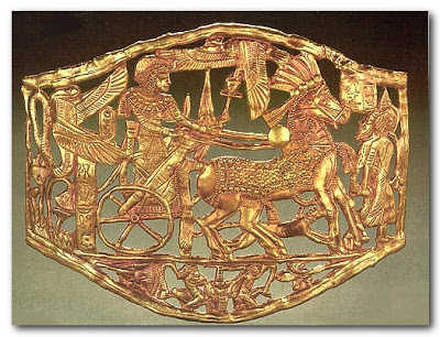 04- Openwork gold buckle showing Tutankhamun in a chariot drawn by two horses.jpg